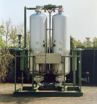 Heated adsorption dryers